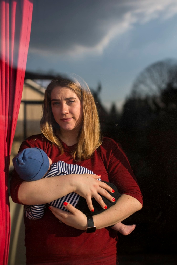 Amber Gorrow holds her 8-week-old son Leon at their home in Vancouver, Washington. He is too young for a measles vaccination right now, so his mother keeps him at home as much as possible to limit his exposure to the disease. Photo: Alisha Jucevic / The Washington Post