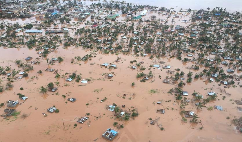 Rooftops and tops of palm trees poke out from underneath flood waters from Tropical Cylone Idai's storm surge and river floods in Beira, Mozambique, 18 March 2019. Photo: MozSARescue