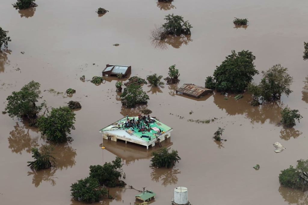 People await rescue on a roof in Beira, Mozambique, after flooding from Cyclone Idai, 18 March 2019. Photo: Rick Emenaket / Mission Aviation Fellowship / AFP / Getty Images