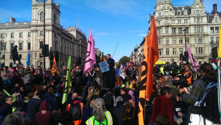 Father Martin Newell, 51, speaks at an Extinction Rebellion protest on Parliament Square in London, United Kingdom, 9 March 2019. Credit: Holly-Anna Petersen / Christian Climate Action
