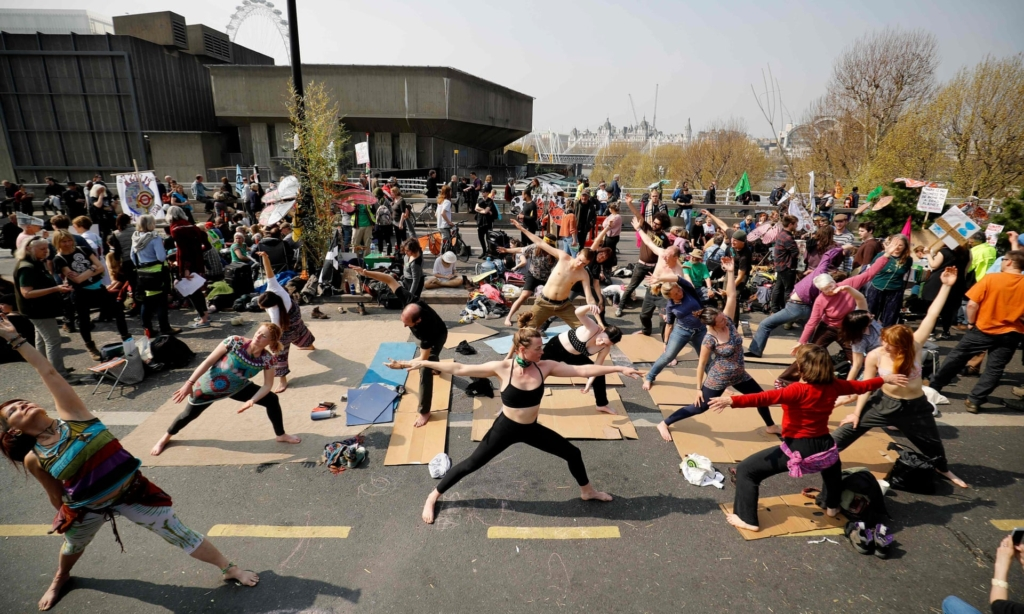 Yoga session on Waterloo Bridge in an Extinction Rebellion protest during the week of 15 April 2019. Photo: Tolga Akmen / AFP / Getty Images