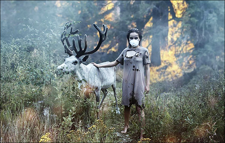 "Yakutsk photographer Natalia Negnyurova created this composite image with a reindeer to attract attention to the threat that Siberian wildfires pose to wildlife. She said, ""After we posted the pictures, many messaged us worrying that 'model' animals were distressed from being so close to fire. We took both pictures in the woods on Yakutia, with a rabbit and a reindeer. The smoke was a bit enhanced while the fire was added later via photo editor"". Photo: Natalia Negnyurova"