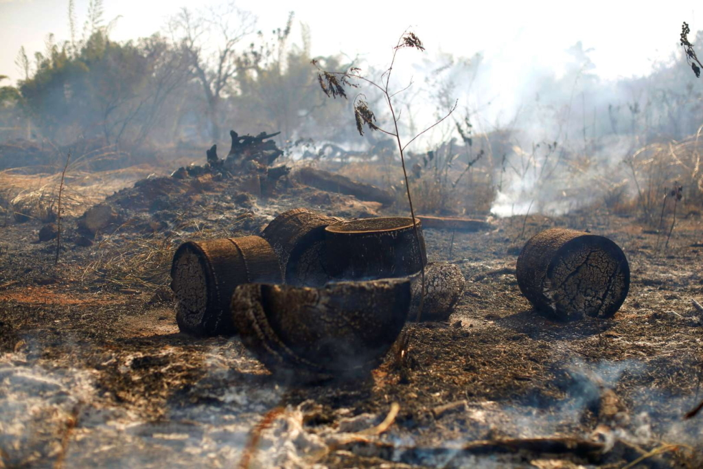 A tract of Amazon jungle burns after being cleared by loggers and farmers on 21 August 2019 in Brasilia, Brazil. Photo: Adriano Machado / Reuters