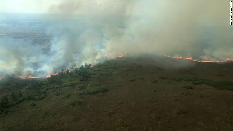 Aerial view of a wildfire burning in the Amazon rainforest near Porto Velho, Brazil, 26 August 2019. The Brazilian state of Rondonia has 6,436 fires burning so far this year in it, according to Brazil's National Institute for Space Research (INPE). Photo: Natalie Gallón / CNN