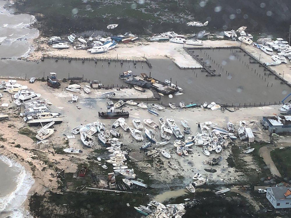 Aerial view of boats littering the area around a marina in the Bahamas on Monday, 2 September 2019, after they were tossed around by Hurricane Dorian. The storm pounded away at the islands in a watery onslaught that devastated thousands of homes, trapped people in attics and chased others from one shelter to another. At least five deaths were reported. Photo: U.S. Coast Guard Station Clearwater / AP