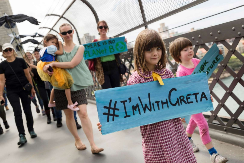 A girl carries a sign that reads #ImWithGreta while marching in the Global Climate Strike in Sydney, Australia, 20 September 2019. Photo: Brook Mitchell / Getty Images