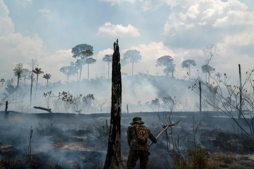 A Brazilian soldier puts out fires at the Nova Fronteira region in Novo Progresso, Brazil, on 3 September 2019. Photo: Leo Correa / AP