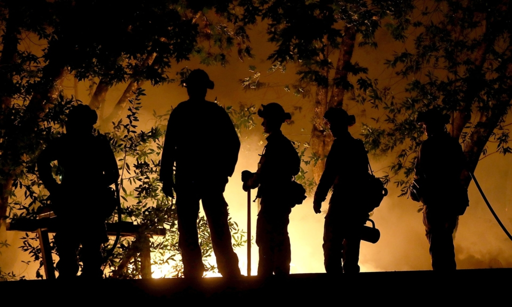 CalFire firefighters monitor a firing operation as they battle the Tubbs fire on 12 October 2017 near Calistoga, California. Photo: Justin Sullivan / Getty Images