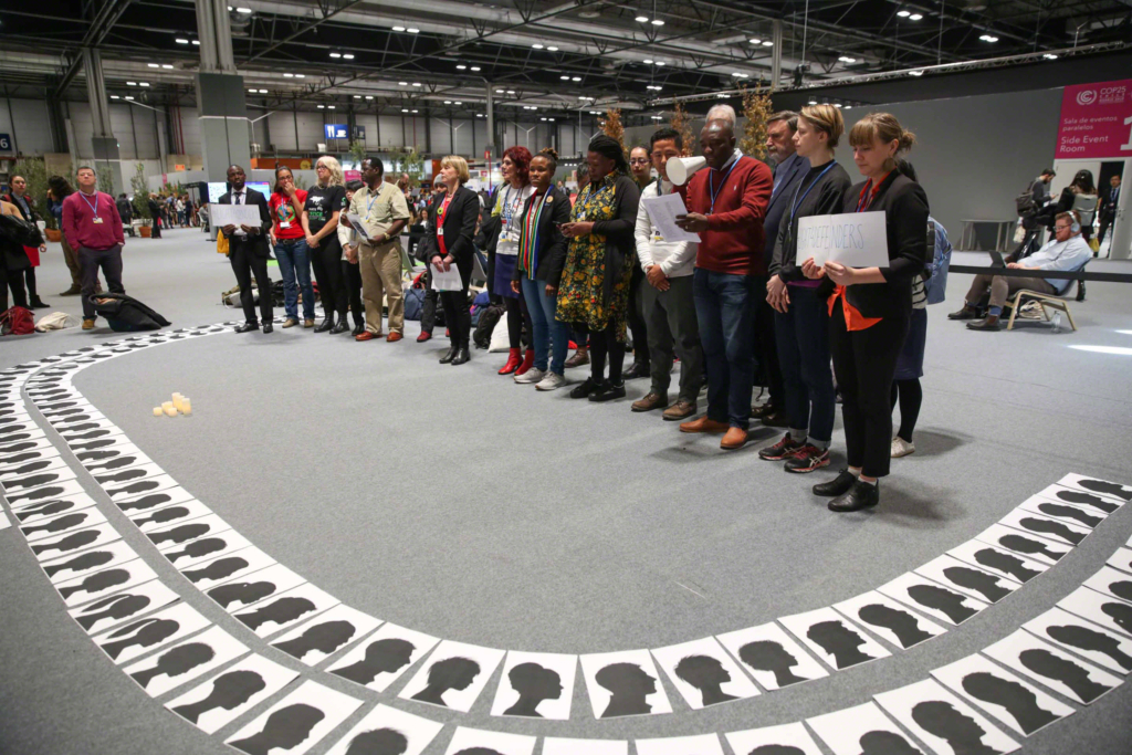 At COP25, members of civil society pay tribute to environmental activists who were killed in the defence of the environment, 9 December 2019. Photo: Kiara Worth / IISD / ENB