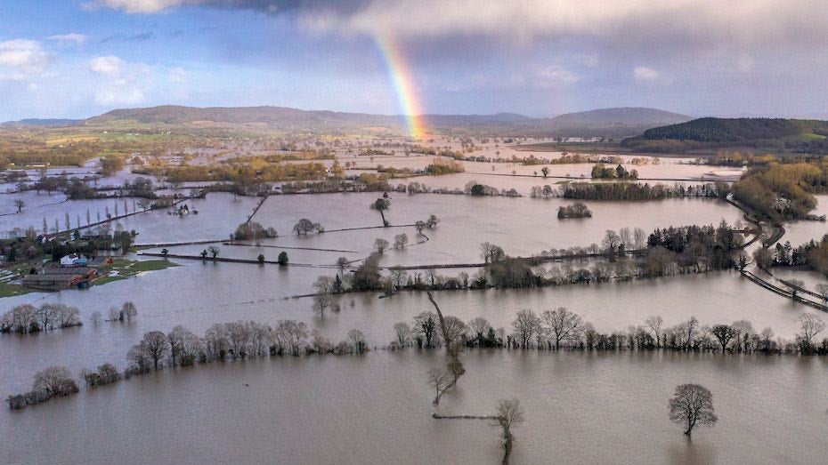 A rainbow appears over flooded fields in the Wye Valley, near the hamlet of Wellesley, in Hereford, England following Storm Dennis on 17 February 2020. Storm Dennis is the second named storm to bring extreme weather in a week, following Storm Ciara. Photo: Christopher Furlong / Getty Images