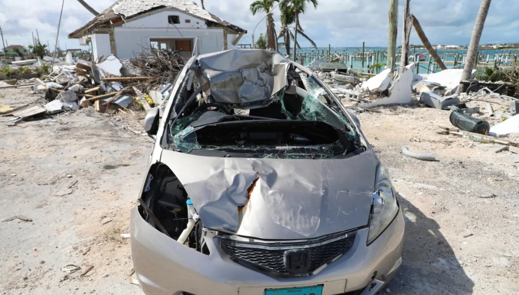 A car and home damaged by Hurricane Dorian show the extent of the damage to the island of Great Abaco even six months after the storm in February 2020. Photo: David Common / CBC