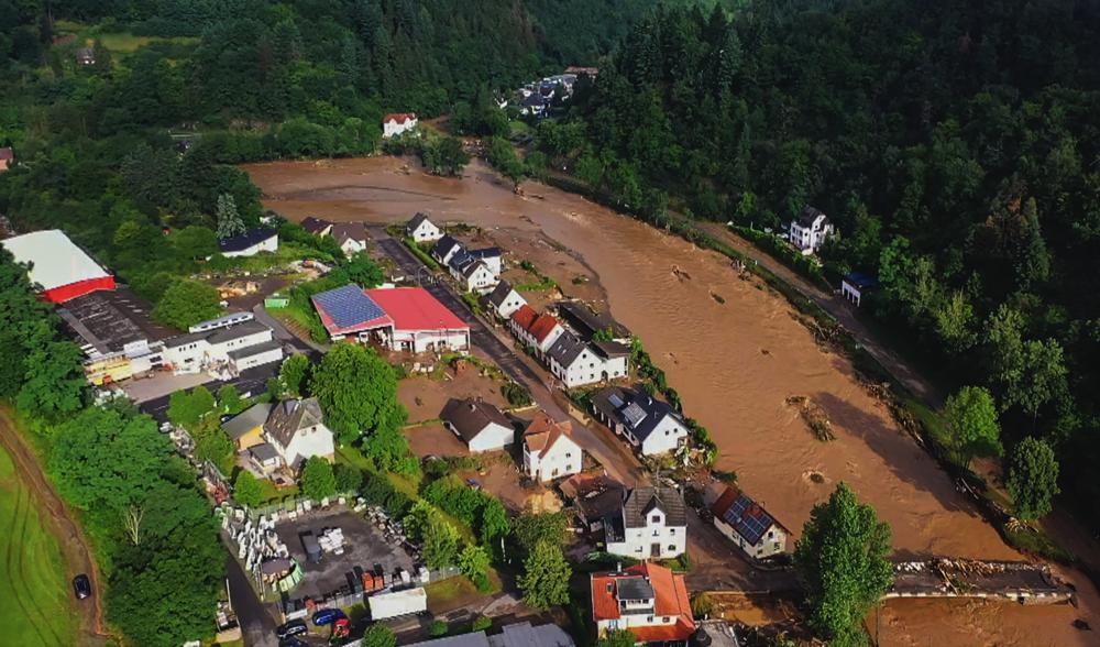 Aerial view of the devastation caused by the flooding of the Ahr River in the Eifel village of Schuld, western Germany, on 15 July 2021. At least 42 people died after record rainfall caused heavy flooding and turned streams and streets into raging torrents, sweeping away cars and causing some buildings to collapse. Photo: Christoph Reichwein / dpa / AP
