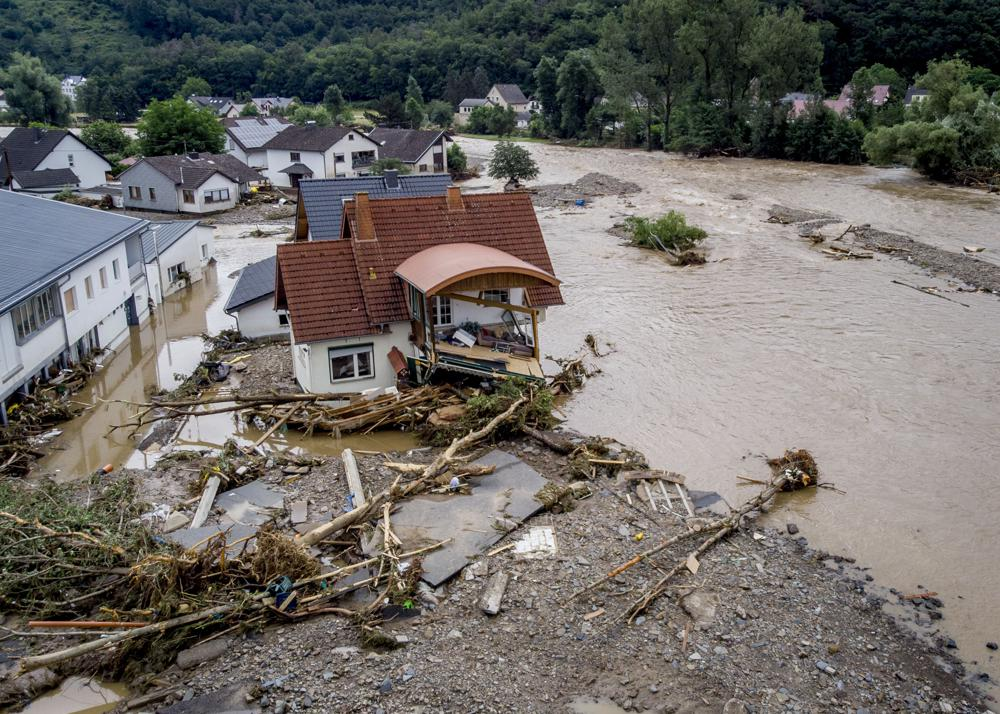 A damaged house is seen at the Ahr river in Insul, western Germany, 15 July 2021. Due to record rainfall the Ahr river dramatically went over the banks the evening before. At least 42 people died after record rainfall caused heavy flooding and turned streams and streets into raging torrents, sweeping away cars and causing some buildings to collapse. Photo: Michael Probst / AP Photo